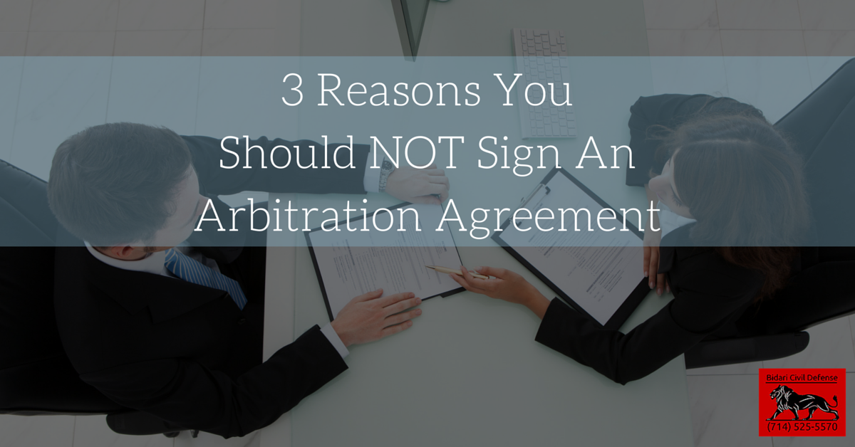 picture of employee signing an arbitration agreement